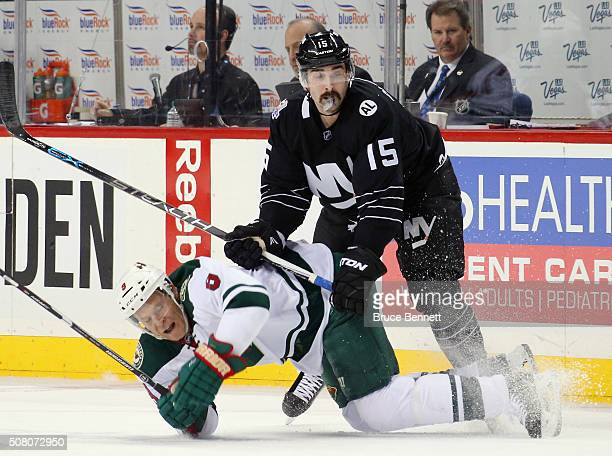 Cal Clutterbuck of the New York Islanders checks Mikko Koivu of the Minnesota Wild during the second period at the Barclays Center on February 2 2016...