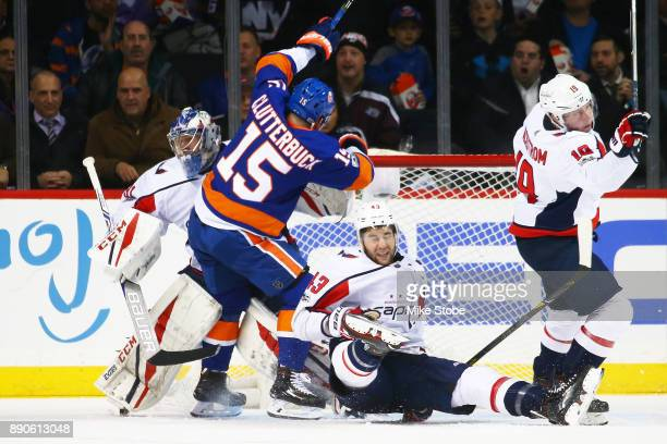 Cal Clutterbuck of the New York Islanders collides with Braden Holtby of the Washington Capitals during the second period at Barclays Center on...