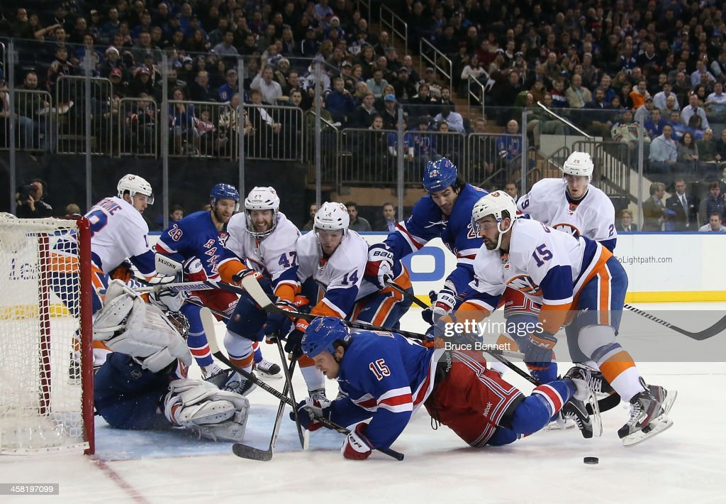 <a gi-track='captionPersonalityLinkClicked' href=/galleries/search?phrase=Cal+Clutterbuck&family=editorial&specificpeople=570497 ng-click='$event.stopPropagation()'>Cal Clutterbuck</a> #15 of the New York Islanders takes a two minute penalty for crosschecking <a gi-track='captionPersonalityLinkClicked' href=/galleries/search?phrase=Derek+Dorsett&family=editorial&specificpeople=4306277 ng-click='$event.stopPropagation()'>Derek Dorsett</a> #15 of the New York Rangers during the second period at Madison Square Garden on December 20, 2013 in New York City.