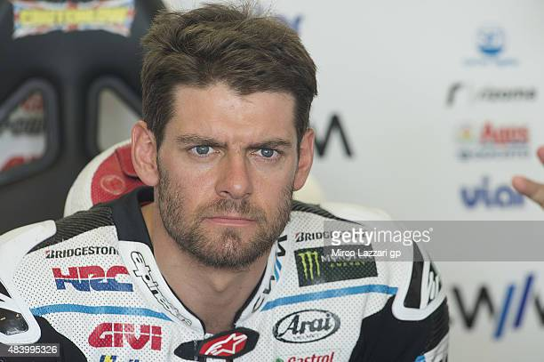 Cal Crutchlow of Great Britain and CWM LCR Honda looks on in box during the MotoGp of Czech Republic Free Practice at Brno Circuit on August 14 2015...