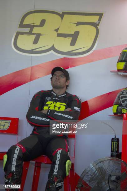 Cal Crutchlow of Great Britain and Ducati team looks on in box during the MotoGP Tests in Valencia Day 2 at Ricardo Tormo Circuit on November 12 2013...