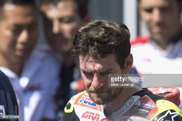 Cal Crutchlow of Great Britain and LCR Honda celebrates the Indipendet team pole position at the end of the qualifying practice during the MotoGp of...