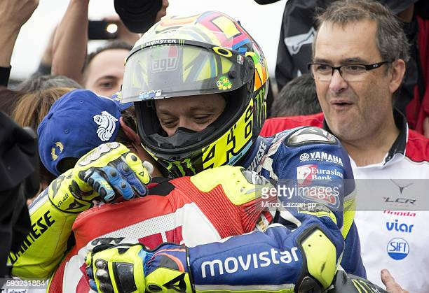 Cal Crutchlow of Great Britain and LCR Honda hugs Valentino Rossi of Italy and Movistar Yamaha MotoGP at the end of the MotoGP race during the MotoGp...