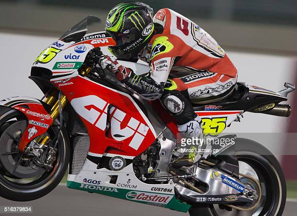 Cal Crutchlow of Great Britain and LCR Honda lifts the front wheel during the MotoGp of Qatar Free Practice at Losail Circuit on March 18 2016 in...