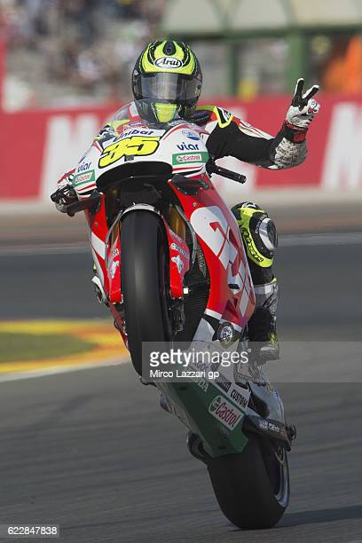 Cal Crutchlow of Great Britain and LCR Honda lifts the front wheel and greets during the MotoGP of Valencia Qualifying at Ricardo Tormo Circuit on...