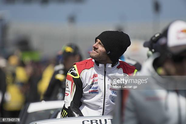 Cal Crutchlow of Great Britain and LCR Honda smiles during the riders parade before the MotoGP race during the MotoGP of Australia Race during the...