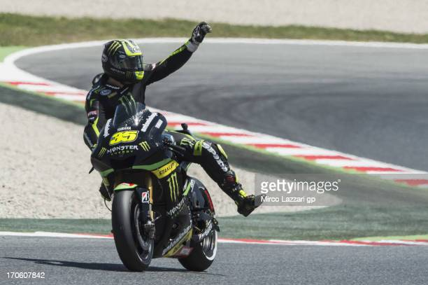Cal Crutchlow of Great Britain and Monster Yamaha Tech 3 greets the fans at the end of the MotoGp Of Catalunya Qualifying at Circuit de Catalunya on...