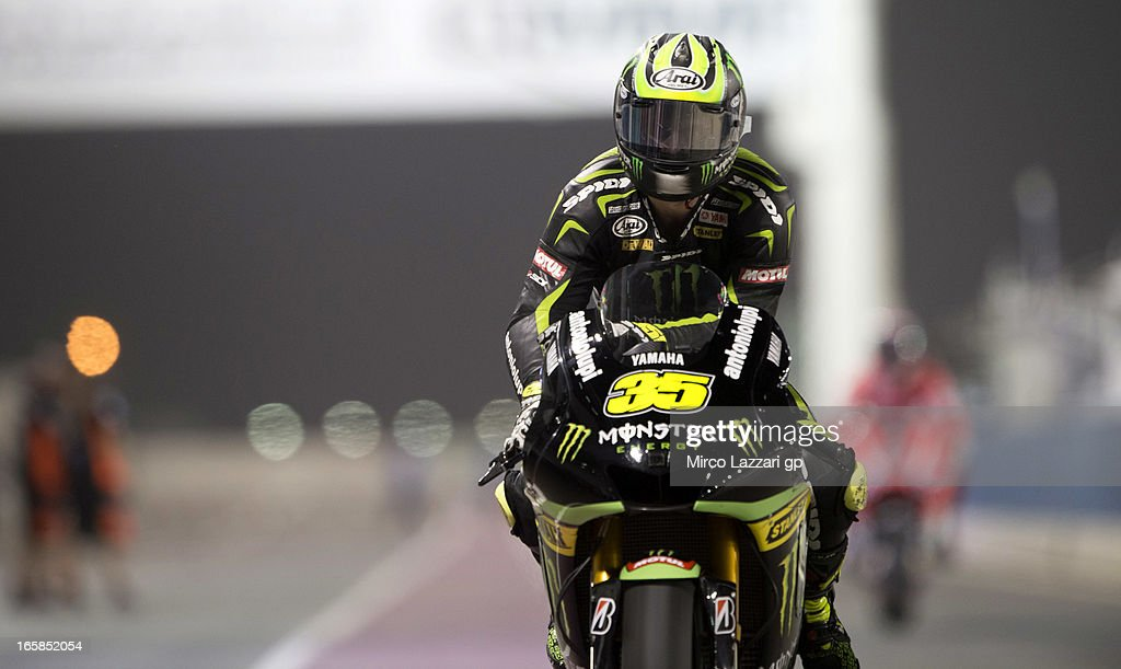 <a gi-track='captionPersonalityLinkClicked' href=/galleries/search?phrase=Cal+Crutchlow&family=editorial&specificpeople=4261131 ng-click='$event.stopPropagation()'>Cal Crutchlow</a> of Great Britain and Monster Yamaha Tech 3 returns in box during the MotoGp of Qatar - Qualifying at Losail Circuit on April 6, 2013 in Doha, Qatar.
