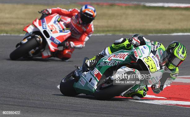 Cal Crutchlow of LCR Honda team and Michele Pirro of team Ducati during MotoGP of San Marino race at Misano World Circuit on September 11 2016 in...