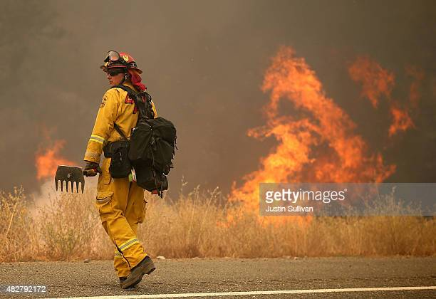 Cal Fire firefighter monitors a backfire during a burn operation to head off the Rocky Fire on August 2 2015 near Clearlake California Over 1900...