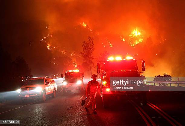 Cal Fire firefighters battle the Rocky Fire on August 2 2015 near Clearlake California Over 1900 firefighters are battling the Rocky Fire that burned...