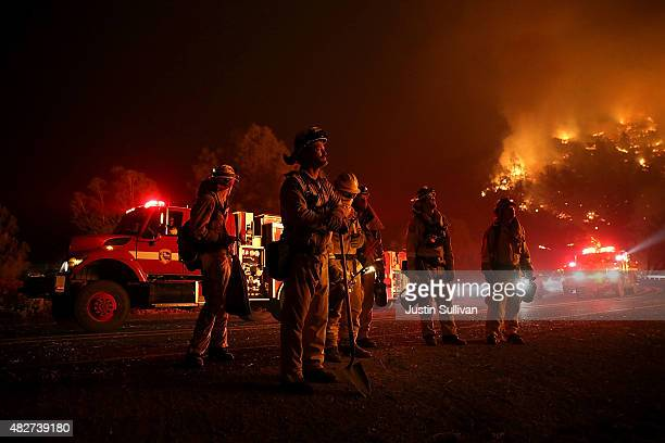 Cal Fire firefighters monitor a backfire ahead of the Rocky Fire on August 2 2015 near Clearlake California Over 1900 firefighters are battling the...