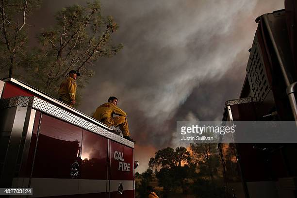 Cal Fire firefighters monitor the progress of the Rocky Fire on August 1 2015 near Clearlake California Over 1900 firefighters are battling the Rocky...