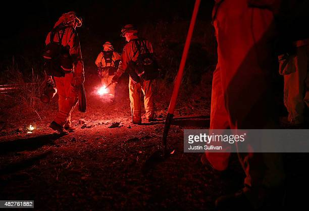 Cal Fire firefighters prepare to use a flare to start a backfire ahead of the Rocky Fire on August 2 2015 near Clearlake California Over 1900...