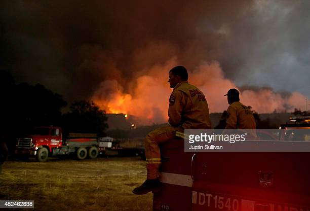 Cal Fire firefighters take a break from battling the Rocky Fire on July 30 2015 in Lower Lake California Over 600 firefighters are battling the Rocky...