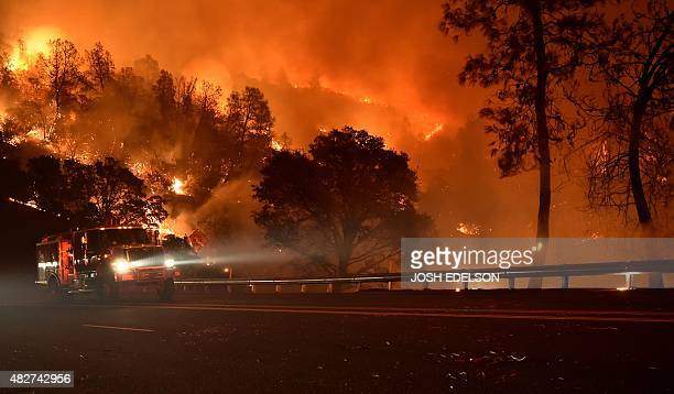 A Cal Fire truck is driven away from flames during the Rocky fire near Clear Lake California on August 2 2015 The fire has charred more than 27000...