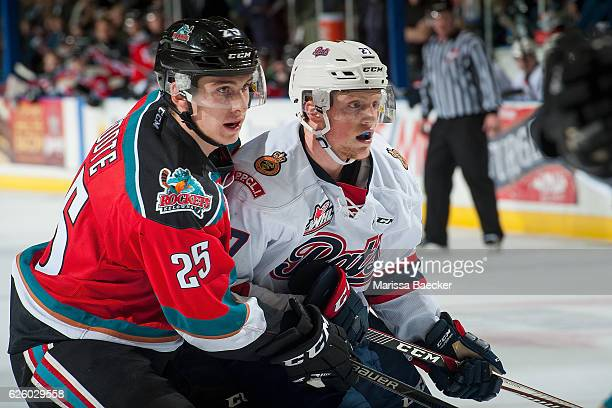 Cal Foote of the Kelowna Rockets checks Austin Wagner of the Regina Pats during second period on November 26 2016 at Prospera Place in Kelowna...