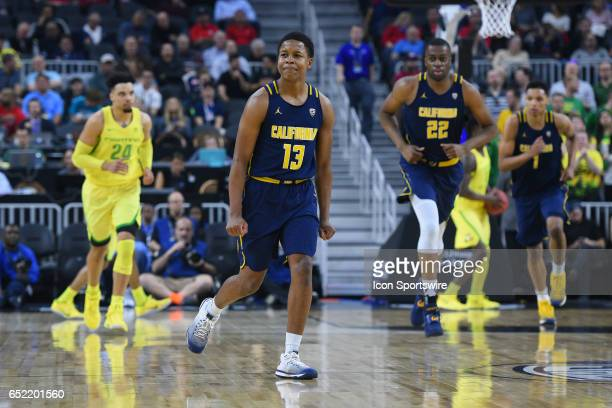 Cal guard Charlie Moore smiles after making a three pointer during the semifinal game of the Pac12 Tournament between the Oregon Ducks and the...