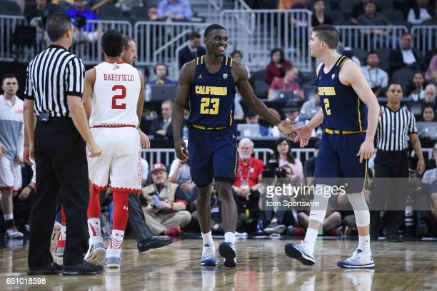 Cal guard Jabari Bird is greeted by Cal guard Sam Singer after making a big three pointer during the quarterfinal game of the Pac12 Tournament...