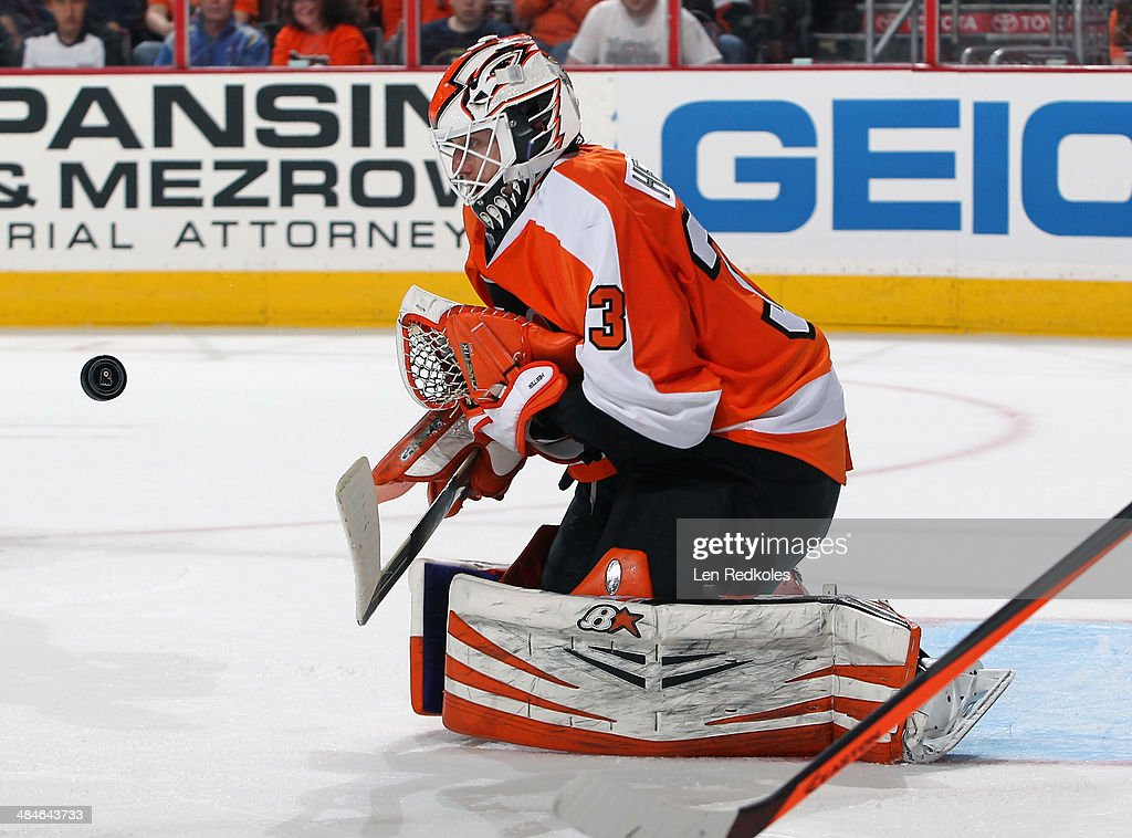 Cal Heeter #33 of the Philadelphia Flyers makes a save against the Carolina Hurricanes on April 13, 2014 at the Wells Fargo Center in Philadelphia, Pennsylvania. The Hurricanes went on to defeat the Flyers 6-5 in a shootout.