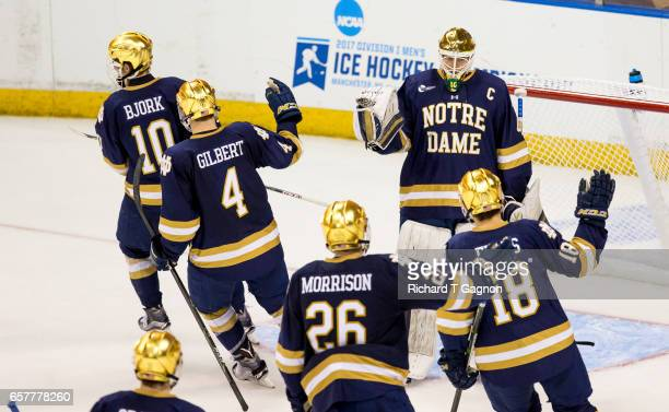 Cal Petersen of the Notre Dame Fighting Irish celebrates with his teammates after a goal against the Minnesota Golden Gophers during game two of the...