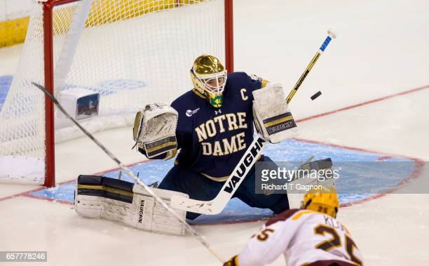 Cal Petersen of the Notre Dame Fighting Irish makes a save against the Minnesota Golden Gophers during game two of the NCAA Division I Men's Ice...
