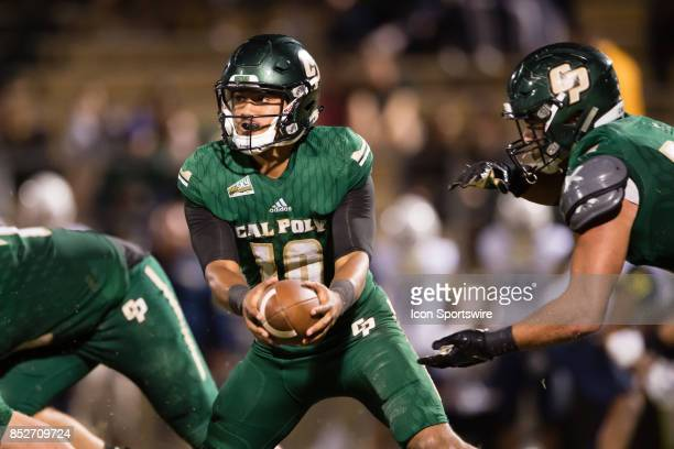 Cal Poly Mustangs quarterback Khaleel Jenkins reaches to hand the ball off during the game between the Northern Arizona Lumberjacks and the Cal Poly...