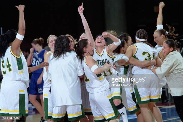 Cal Poly Pomona celebrate after defeating Southeastern Oklahoma State University during the NCAA Division 2 Women's Basketball Championship held at...