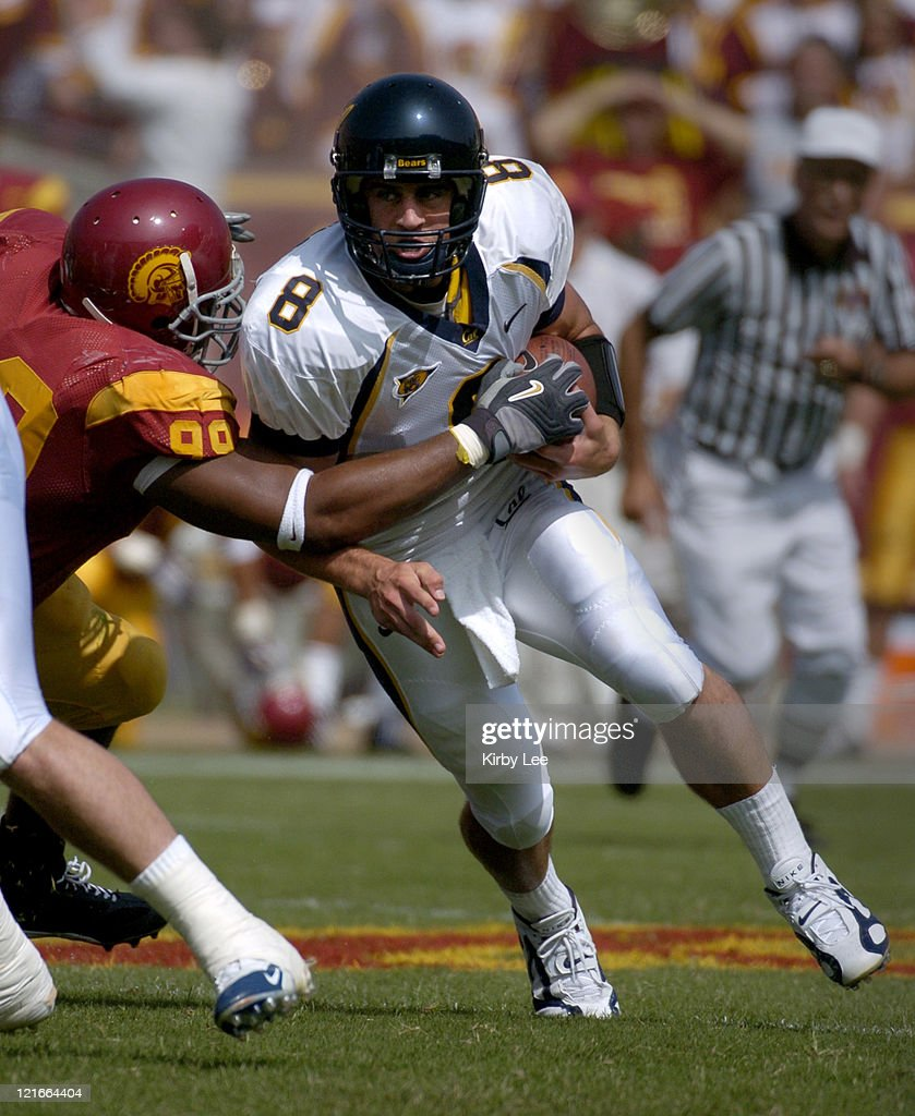Cal quarterback Aaron Rodgers tries to break free from grasp of USC nose guard Mike Patterson during 2317 loss in Pac10 Conference football game at...
