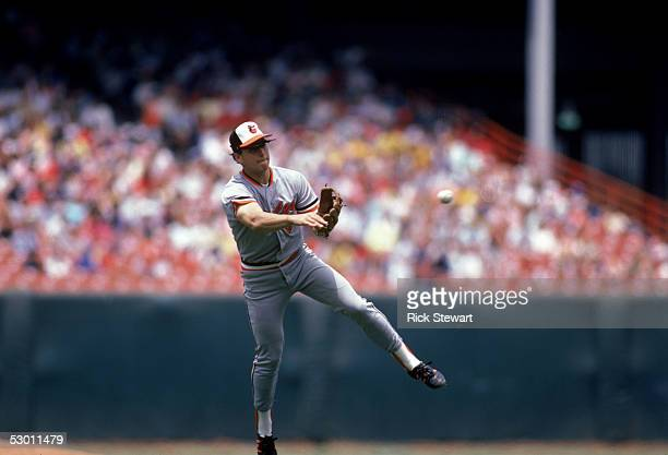 Cal Ripken Jr #8 of the Baltimore Orioles throws the ball during a game in the 1986 season against the California Angels at Anaheim Stadium in...