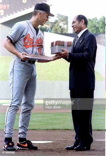 Cal Ripken Jr and Sachio Kinugasa of Japan exchange gifts at home plate prior to the OriolesRoyals game at Kauffman Stadium in Kansas City Missouri...