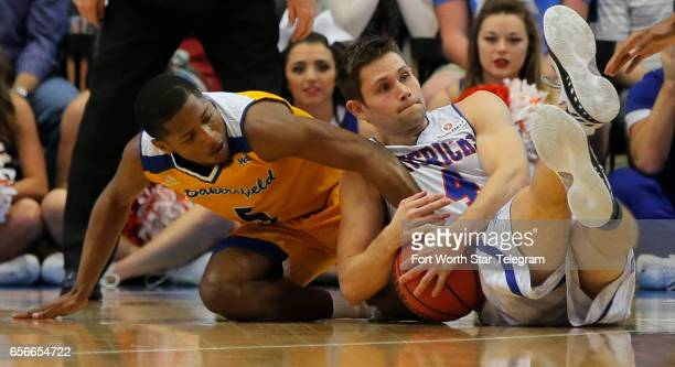 Cal State Bakersfield's Dedrick Basile and TexasArlington's Drew Charles fight for a loose ball in a National Invitation Tournament quarterfinal at...