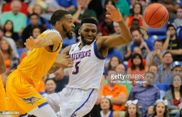 Cal State Bakersfield's Jaylin Airington and TexasArlington's Kaelon Wilson fight for the ball in a National Invitation Tournament quarterfinal at...