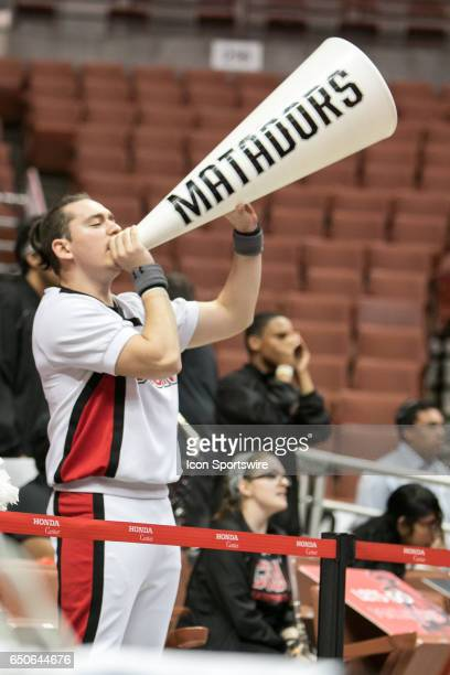 Cal State Northridge Cheerleader yells out of a megaphone during a Big West Conference Quarterfinals game between Cal State Fullerton and Cal State...