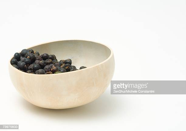 Calabash gourd bowl containing dried berries