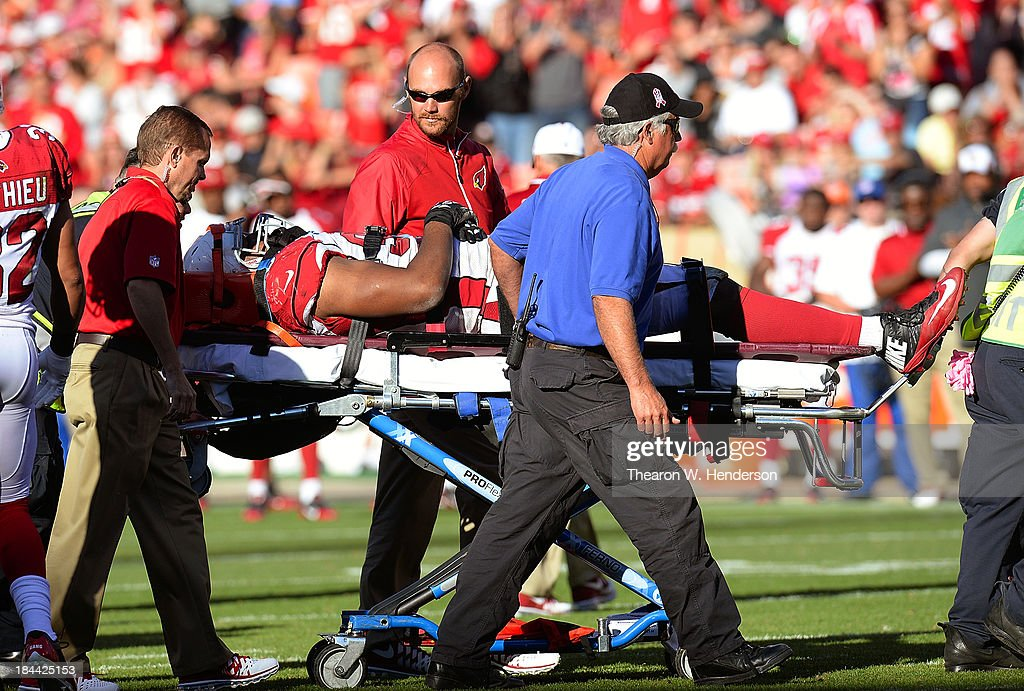 Calais Campbell #93 of the Arizona Cardinals is carried off the field on a stretcher after he was injured during the fourth quarter against the San Francisco 49ers at Candlestick Park on October 13, 2013 in San Francisco, California. The 49ers won the game 32-20.