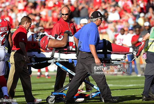 Calais Campbell of the Arizona Cardinals is carried off the field on a stretcher after he was injured during the fourth quarter against the San...