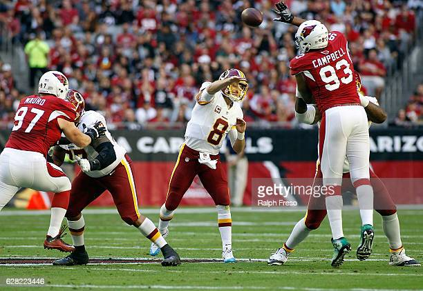 Calais Campbell of the Arizona Cardinals leaps to block the pass of quarterback Kurk Cousins of the Washington Redskins during the first quarter of a...