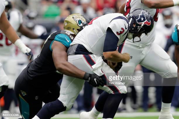Calais Campbell of the Jacksonville Jaguars sacks Tom Savage of the Houston Texans in the second quarter at NRG Stadium on September 10 2017 in...