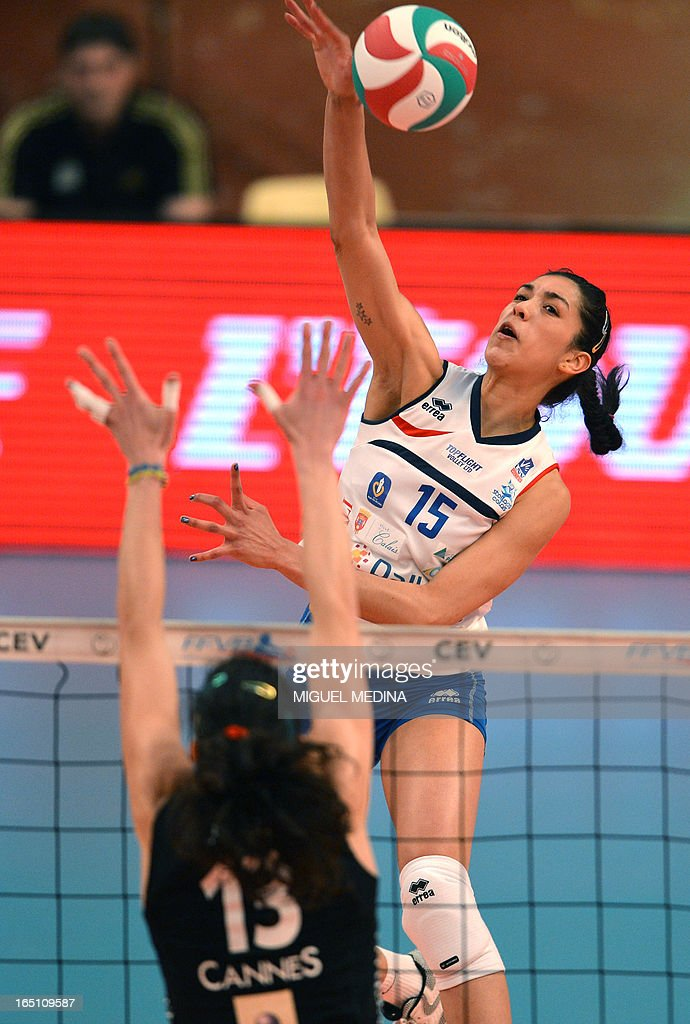Calais' Maria Jose Perez Gonzalez (R) jumps to spike during the Women French Championship volleyball final match Cannes vs Calais on March 30, 2013 at the Coubertin Stadium in Paris. AFP PHOTO / MIGUEL MEDINA