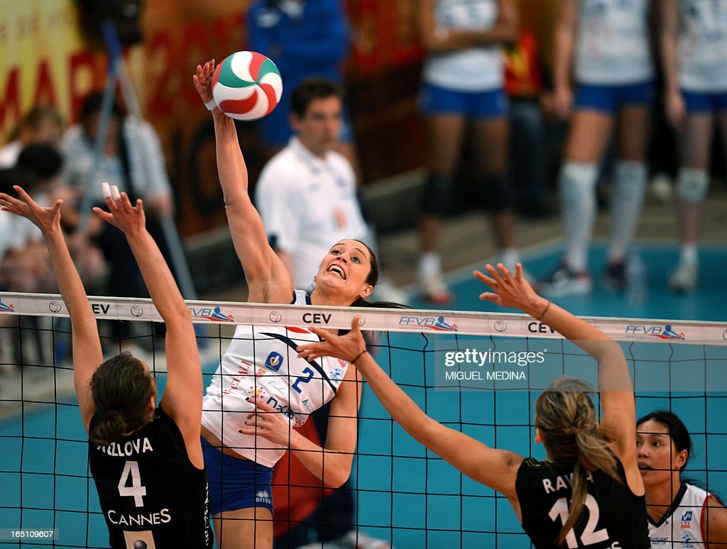 Calais' Tamara Matos Hoffmann (2nd L) jumps to spike during the Women French Championship volleyball final match Cannes vs Calais on March 30, 2013 at the Coubertin Stadium in Paris.