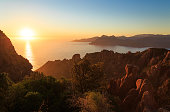 Cliffs and coast of a Mediterranean island during sunset. Calanche de Piana and the Golf of Porto, Corsica, France.