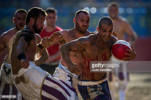 Calcianti of La Santa Croce Azzurri Team take on Santo Spirito Bianchi Team during the semifinal match of the Calcio Storico Fiorentino at Piazza...