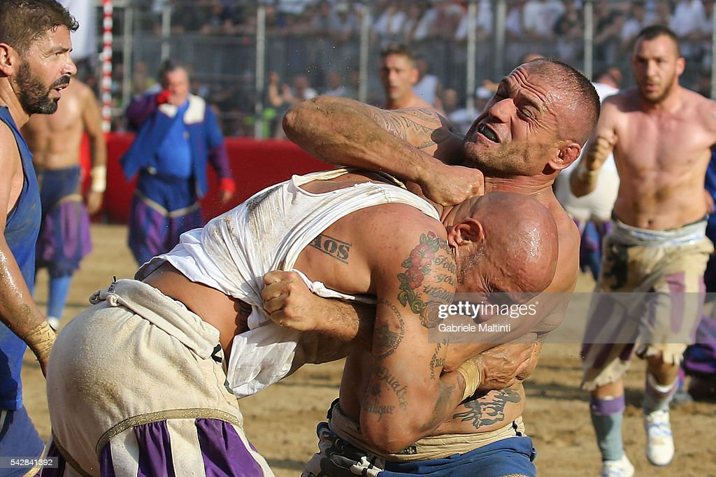 Calcianti (Players) of the Santo Spirito Bianchi (white) Team and Santa Croce (blue) Team fight during the final match at the La Santa Croce square on June 24, 2016 in Florence, Italy.