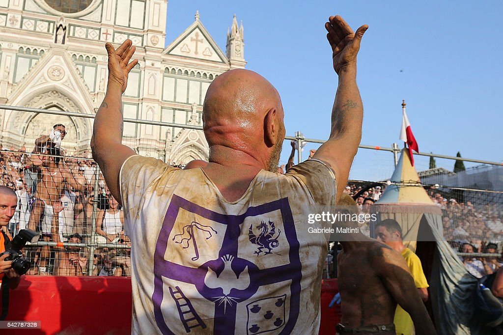 Calcianti (Players) of the Santo Spirito Bianchi Team celebrate after defeating the Santa Croce Azzurri Team during the final match at the La Santa Croce square on June 24, 2016 in Florence, Italy.