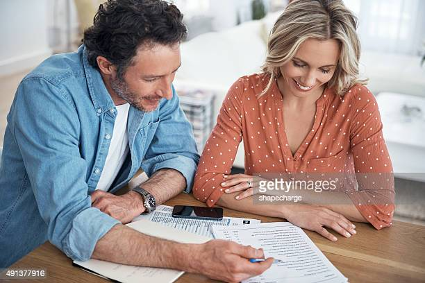 Calculating their monthly income and expenditure