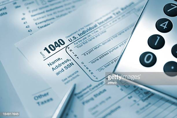 calculator and pen on US tax return form