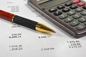 calculator and pencil laying on financial business account