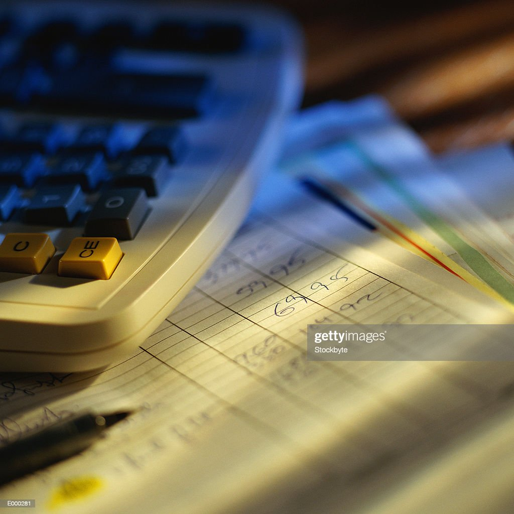 Calculator and pencil on top of balance sheet : Stock Photo