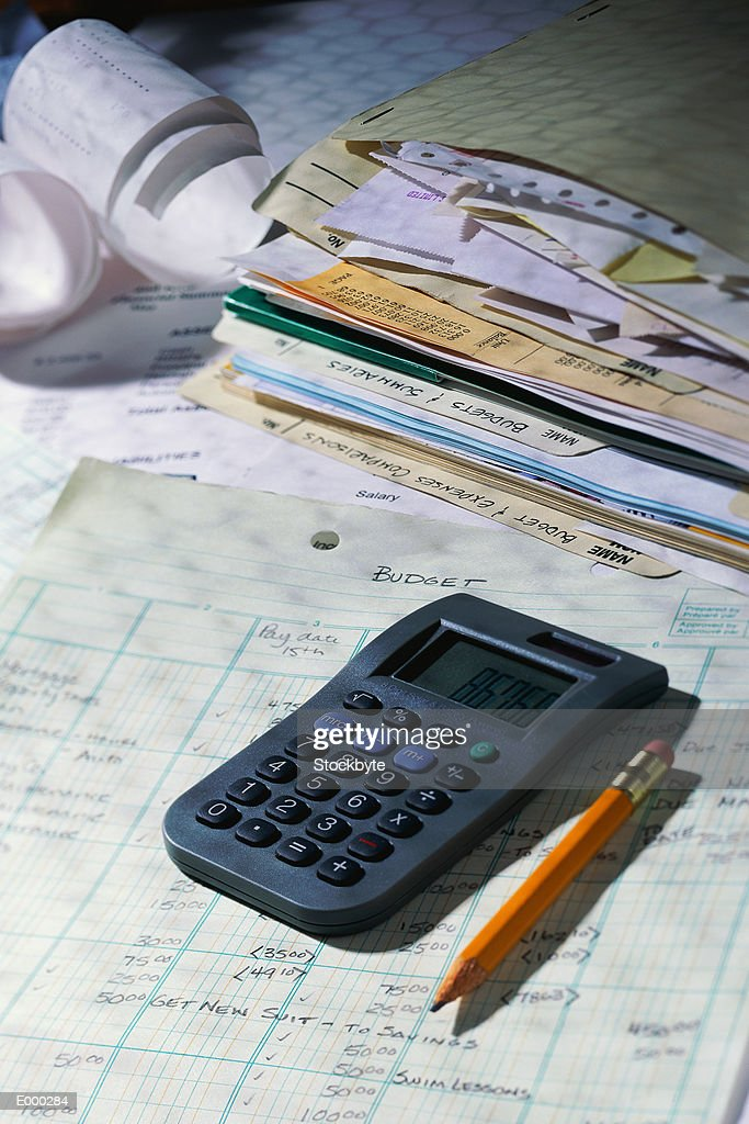 Calculator and pencil on top of budget sheet